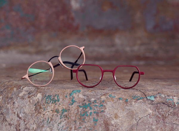 Peach and red coloured eye glasses